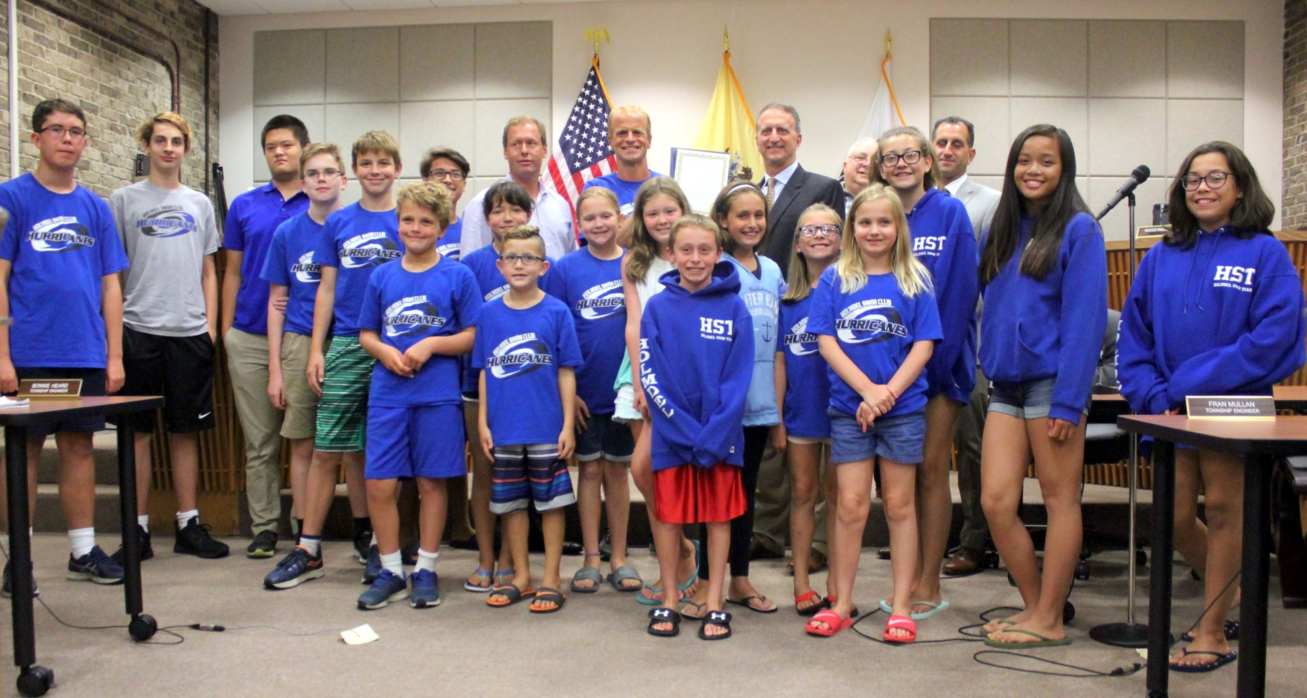 The Holmdel Hurricanes Swim Team shown being honored with an official proclamation from the Township